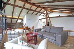 44-Penthouse-Wohnzimmer-von-Verglasung-aus-K Gut Stohrerhof