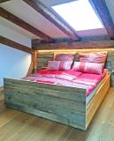 Doppelbett im Penthouse Gut Stohrerhof am Ammersee